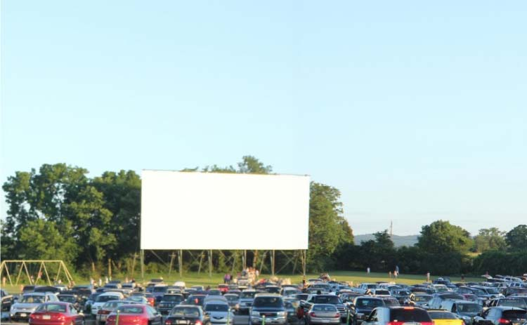 Cars park in front of the screen at the Cumberland Drive-In Theatre in Newville